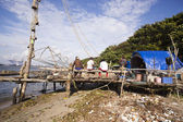 Fishermen with Chinese fishing nets at a harbor — Stock Photo