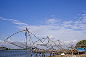 Fishermen with Chinese fishing nets — Stock Photo