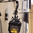 Lantern hanging on the wall of a house — Stock Photo