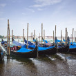 Stock Photo: Gondolas moored at dock