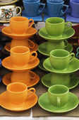 Display of tea cups with saucers — Stock Photo