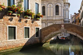 Buildings along a canal with a footbridge — Stock Photo