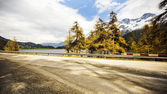 Road at lakeside in the valley — Stock Photo