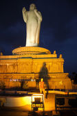 Statue of Buddha lit up at night — Stock Photo