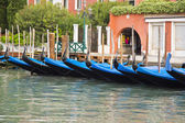 Gondolas anchored in a canal — Stock Photo