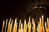 Burning votive candles in the Como Cathedral — Stock Photo