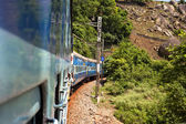 Train moving on a railroad track — Foto Stock