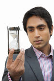 Businessman looking at an hourglass — Stock Photo