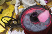Vendor making pink cotton candy — Stock Photo