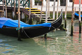 Gondola anchored in a canal, Venice — Stock Photo