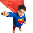 Boy dressed as a superman standing with his hand raised — Stock Photo