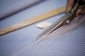 Close-up of a fabric being cut by scissors — Stock Photo