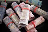 Close-up of rolled-up Indian paper currency — Stock Photo