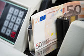 Fifty Euro notes being counted in a machine — Stock Photo