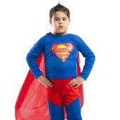 Boy dressed as a superman standing with his arm akimbo — Stock Photo