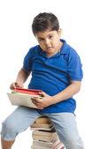 Boy holding books — Stock Photo