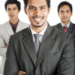Portrait of a businessman smiling with his colleagues in the background — Stock Photo #33345769