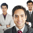 Portrait of a businessman smiling with his colleagues in the background — Stock Photo #33345985