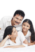 Portrait of a girl smiling with her parents — Stockfoto