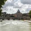 Stock Photo: Bridge across a river with a basilica in the background