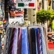 Stock Photo: Ties for sale at market stall