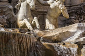 Sculptures on a fountain — Stock Photo