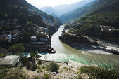 Confluence of the Alaknanda and Bhagirathi rivers to form the Ga — Stock Photo
