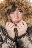 Young girl wearing winter coat warming herself — Stock Photo