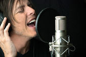 Man Sings Into Condenser Microphone — Stock Photo
