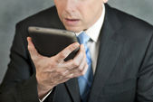 Businessman Looks At Tablet With Despair — Stock Photo