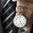 BusinessmHolding Pocketwatch — Stock Photo #31503609