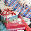 Stock Photo: MUnrolling Wrapping Paper