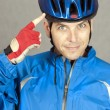 Cyclist Points To His Helmet — Foto Stock