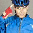 Cyclist Points To His Helmet — Stock Photo