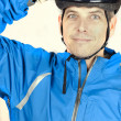 Stock Photo: Cyclist Puts On Helmet