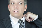 Worried Businessman Adjusts Collar — Stock Photo