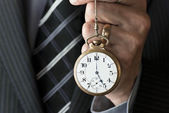 Businessman Holding Pocketwatch — Stock Photo