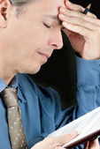 Stressed Businessman Rubs Forehead — Stock Photo
