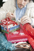 Man Concentrating On Gift Wrapping — Stock Photo