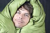 Happy Man In Dwn Sleeping Bag — Stock Photo