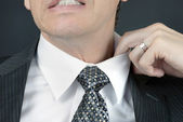 Uncomfortable Businessman Adjusts Collar — Stock Photo