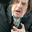 Stock Photo: BusinessmExperiencing Heart Attack