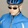 Foto Stock: Cyclist Looks To Camera