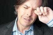 Stressed Businessman Rubs Eyes — Stock Photo