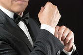 Man In Tux Fixes Cufflink — Stock Photo