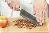 Chef Chops Pecans — Stock Photo