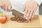 Chef Chopping Pecans — Stock Photo