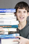 Terrified Teen Holds Stack Of Textbooks — Stock Photo