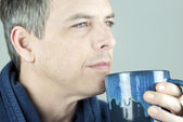 Serene Man Holding Mug Looking Off Camera — Stock fotografie