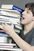 Teen Tries To Carry Unbalanced Stack Of Textbooks — Stock Photo